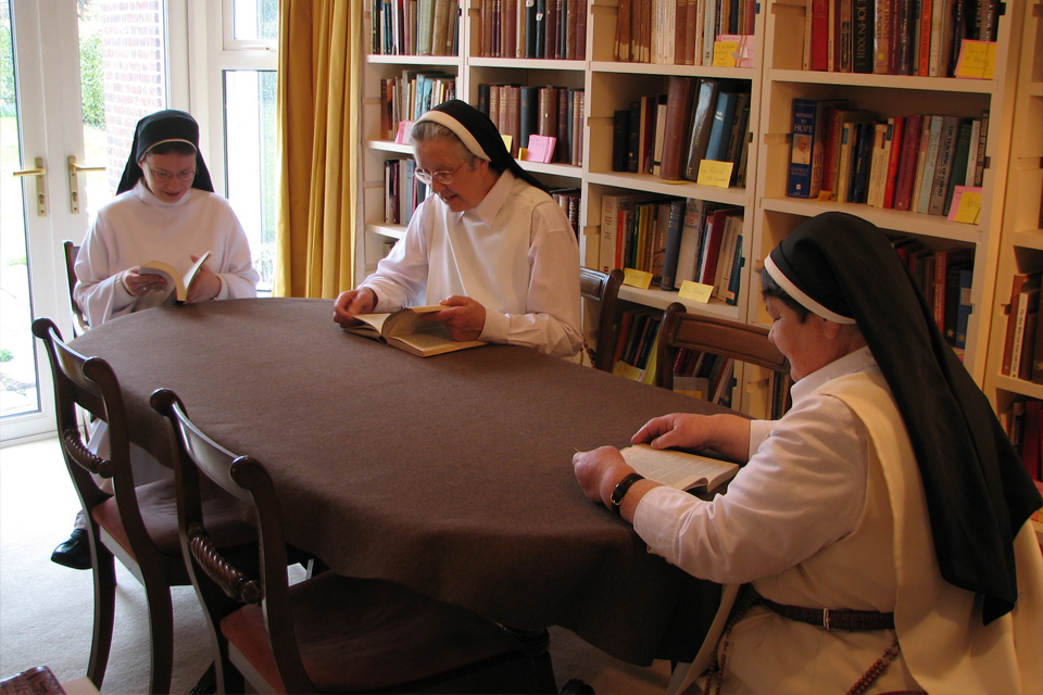 Sisters in the library at Cambridge