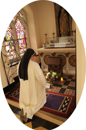 A Sister kneels at St Catherine's Shrine, where arelic of St catherine is preserved.